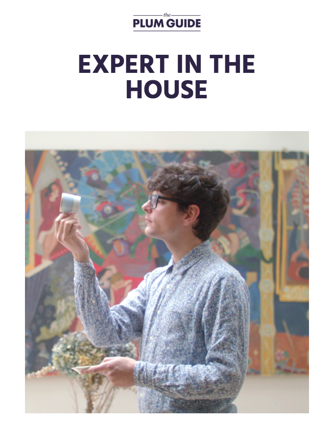 A house interior expert who examines a piece of furniture