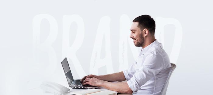 Sitting man with laptop