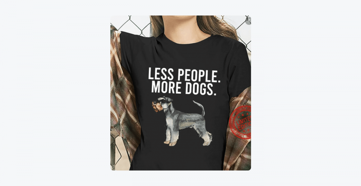 """Picture of a woman wearing a t-shirt with  """"Less people. More dogs."""" written on it"""